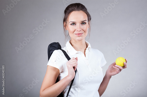 Woman going on tennis match