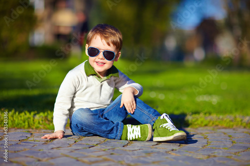 fashionable kid in summer park