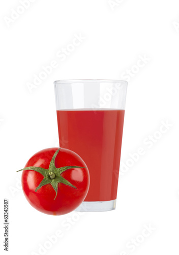 Glass of fresh tomato juice with tomato