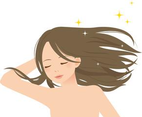 風になびく髪を触る女性