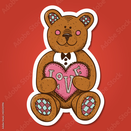 Teddy bear with heart present.