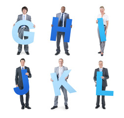 Group of Business People Holding the Letter