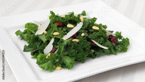 Kale salad served on a square plate.
