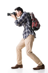 Asian young male backpacker take a picture
