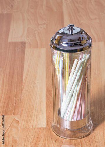 Many straws in a holder mane of glass