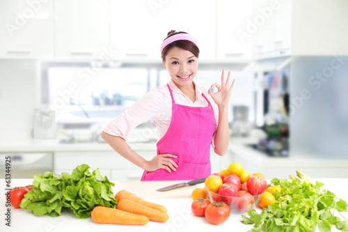Happy smiling woman in kitchen