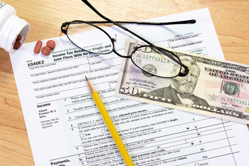 Tax form and objects with a pencil