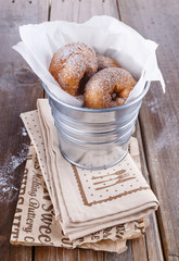 Cinnamon doughnuts in a metal bucket