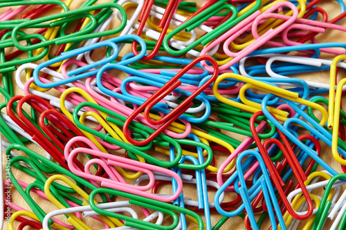 colorful paper clip on table