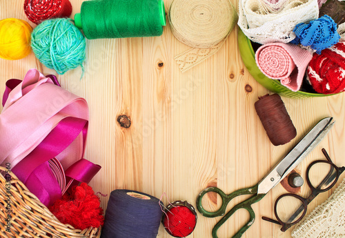 Frame of sewing on a light wooden background