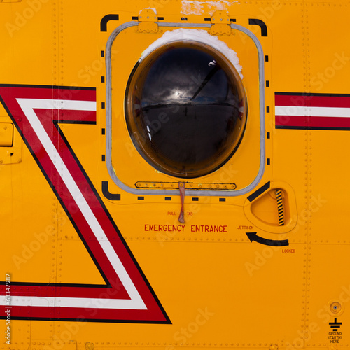 Helicopter porthole window mirrors rotor blade