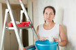 weariness  woman makes repairs at home