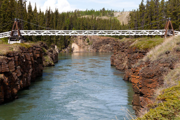 Swing bridge across Miles Canyon of Yukon River
