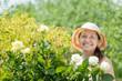 Female gardener in rose plant
