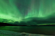 Aurora borealis night sky over frozen Lake Laberge