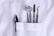Dentist pocket with pens and other equipment, close-up