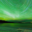Aurora borealis startrails frozen Lake Laberge