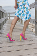 Mature woman in very high heel shoes outdoor