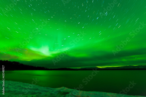 Aurora borealis starry night sky over Lake Laberge