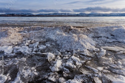 Shore ice piling up Lage Laberge Yukon Canada
