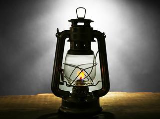 Kerosene lamp on dark grey background