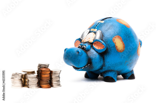cow piggy bank with coins