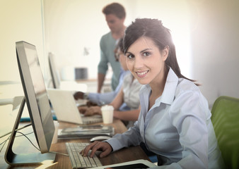 Cheerful young woman attending business training