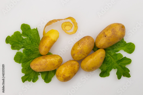 fresh raw potatoes and lettuce