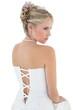 Bride in off shoulder dress looking away