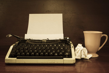 Typewriter with coffee cup