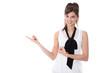 Hübsche junge business Frau zeigt mit dem Finger auf etwas