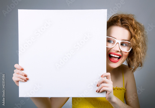 Smile woman with blank white board or panel