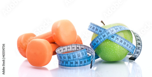 canvas print picture Dumbbell with apple and measure tape