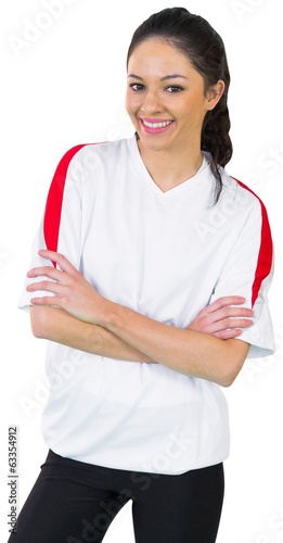 Pretty football fan in white smiling