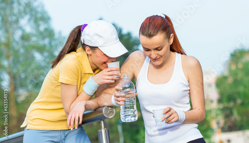 Friendship of two young girlfriends in healthy lifestyle