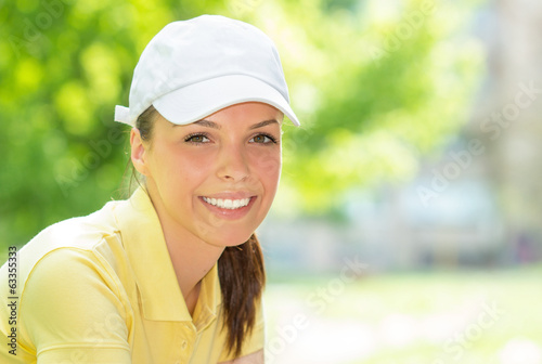 Portrait of a smiling young sports woman