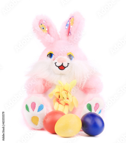Pink toy rabbit with easter eggs.