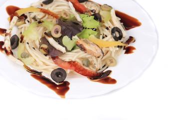 Sea salad with spaghetti
