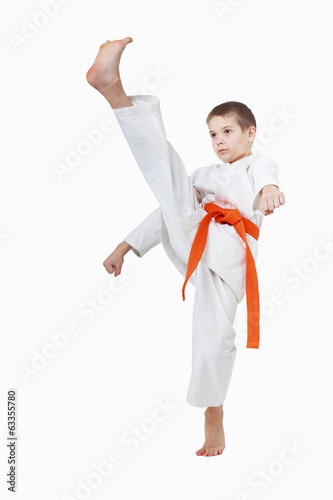 With the orange belt boy is a beating a high kick leg