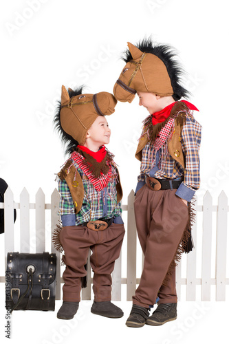 Two boys wearing horse costumes