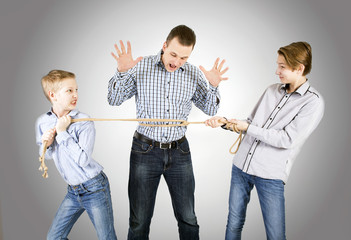 Father and two sons connected by rope