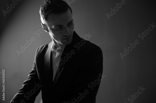 Portrait of a thoughtful businessman looking away