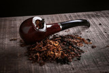 Fototapety pipe and tobacco on wooden surface