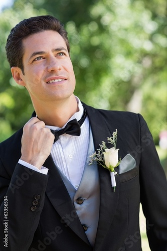 Nervous bridegroom in garden
