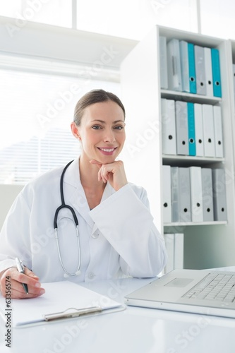 Doctor sitting at desk in clinic