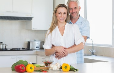 Affectionate couple preparing a vegetarian dinner together