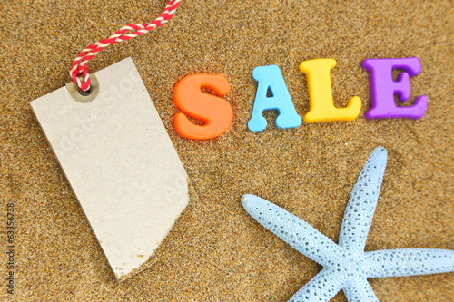 canvas print picture Blank tag, colorful sale text and starfish on sand