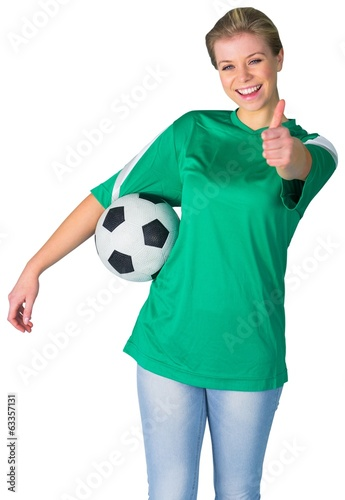 Happy football fan in green