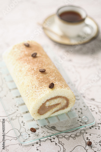 Coffee Swiss Roll Cake on light background