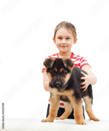child with German Shepherd Dog